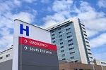 Photo of an H sign in front of a hospital